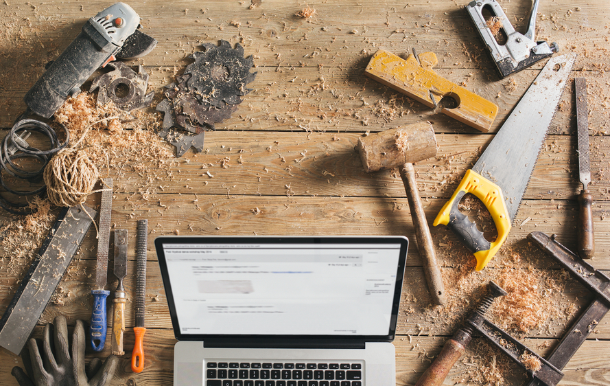 Carpenter's worspace -present day view of various professions combined with modern technology.