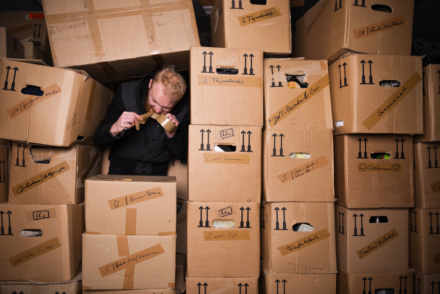 Man surrounded by moving boxes  - Adobe RGB