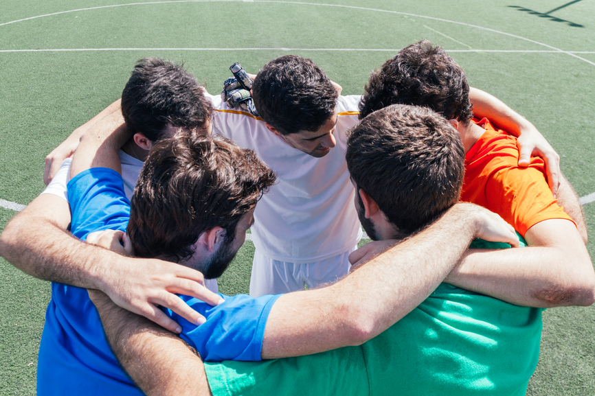 Soccer players giving encouragement themselves before a soccer m