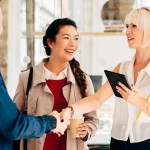 Happy Business people arrive at meeting greeting handshake at work at trendy startup company